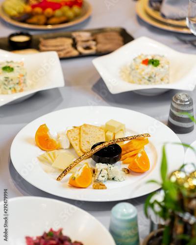 Fototapeta Aperitive plate with mixed aperitives