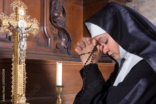 Leinwand Poster Novice in prayer