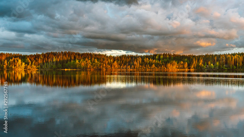 Photo The sunset view by the lakeside next to a campsite Koli Freetime Oy in Finland L