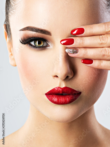 Canvas Print beautiful woman with bright fashion make-up and red nails
