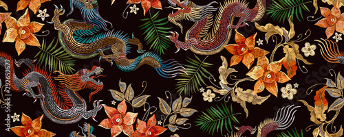 Fotografie, Obraz Embroidery asian dragon and beautiful yellow daffodils flowers seamless pattern