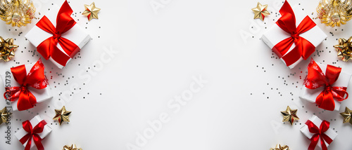 Christmas and New Year holiday background. Xmas greeting card. Christmas gifts on white background top view. Noel. Flat lay