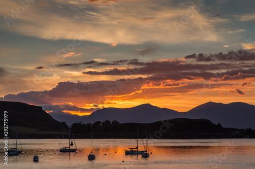 Obraz na plátně Orange Sunset Over the Harbor of Oban, Scotland