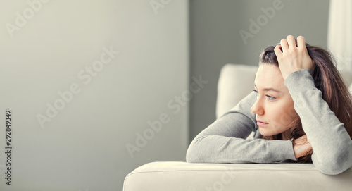 Fotografie, Tablou Depressed young woman on sofa at home.