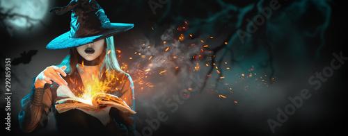 Fotografia, Obraz Halloween Witch girl with magic Book of spells portrait