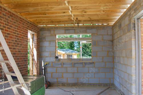 Residential renovation project unfinished garage in building blocks, roof struct Fototapet