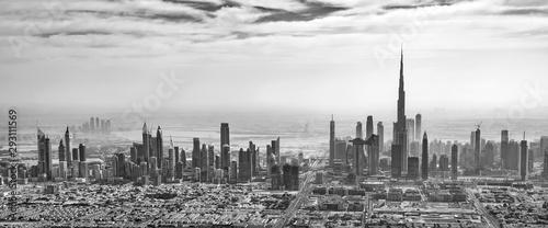 Panoramic aerial view of Dubai skyline in black and white, United Arab Emirates
