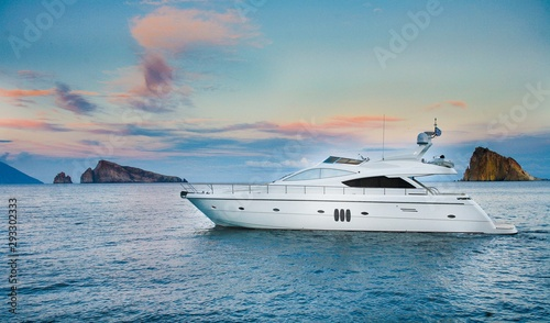 Fotografie, Obraz yacht in the sea at sunset