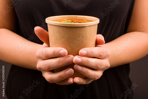 Fototapeta Chinese hot and sour soup in takeaway cup.