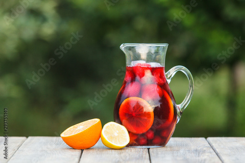 Obraz na plátně Refreshing sangria or punch with fruits in pincher