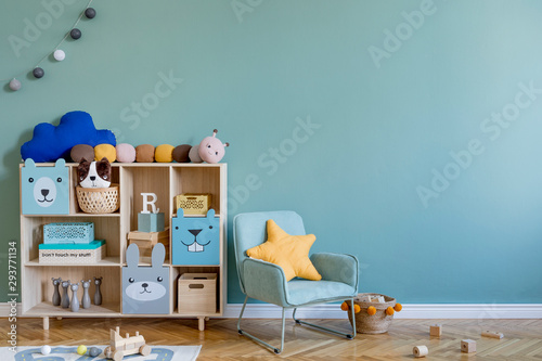 Tapete Scandinavian nursery room with wooden cabinet, mint armchair, natural teddy bears and plush animal toys. Cute modern interior of playroom with eucalyptus walls, baby accessories and toys. Copy space.