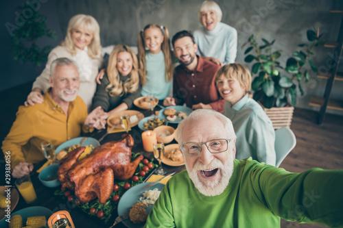 Fotografia, Obraz Photo of big family sit hugging feast dishes table around roasted turkey multi-g
