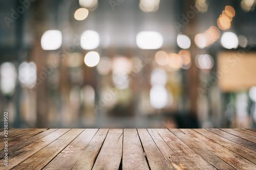 Empty wooden table top with lights bokeh on blur restaurant background Fototapeta