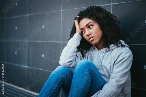 Fotografija Sad and lonely teenager portrait in the city street