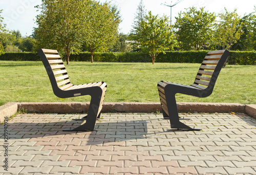 two benches facing each other in the garden Fototapeta