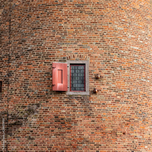 Photo Medieval Castle Tower Walls with Tiny Shuttered Window