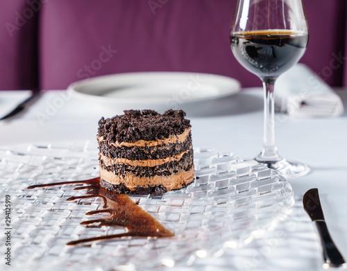 Obraz na plátně chocolate cake with sherry in restaurant