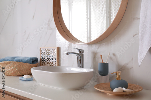 Photographie Stylish bathroom interior with vessel sink and decor elements