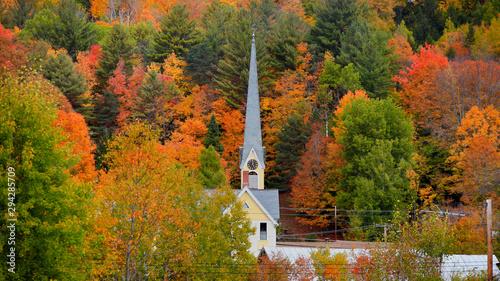 Photo Church steeple between autumn trees in east Royalton Vermont