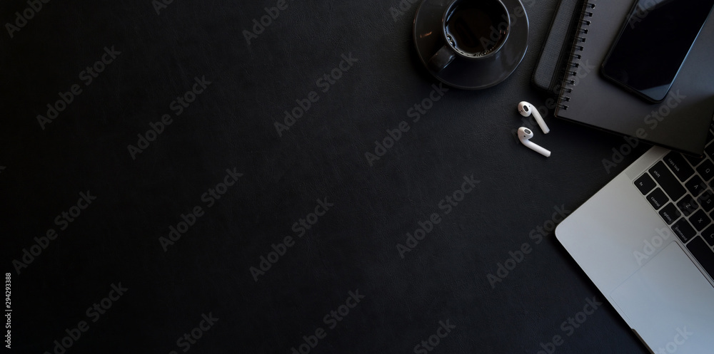 Modern workplace with dark luxury style with copy space and office supplies - obrazy, fototapety, plakaty