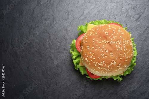 Fotografiet Classic cheeseburger on black slate background