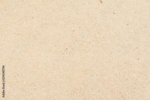 Closeup brown beige sheet of craft cardboard paper texture background.