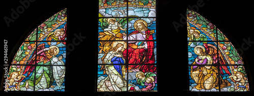 Obraz na plátne ARCO, ITALY - JUNE 8, 2018: The Annunciation in the stained glass  in the church Chiesa Collegiata dell'Assunta