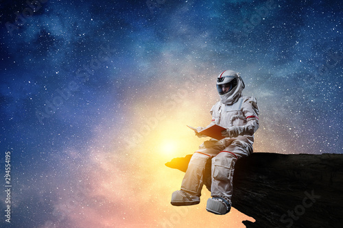 Tableau sur Toile Spaceman and the planet Earth abstract theme