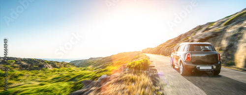 Photographie rental car in spain mountain landscape road at sunset