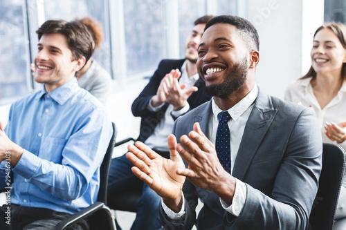 Fotografia Happy businessmen applauding good presentation in office