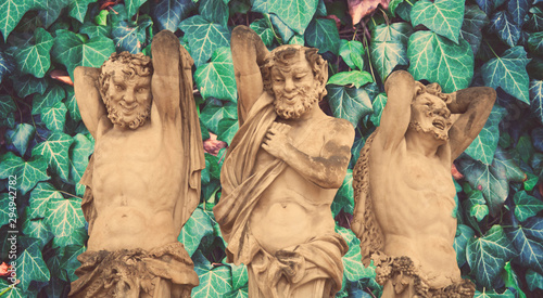 Fotografie, Obraz Antique statue of Satyrs against ivy leaves