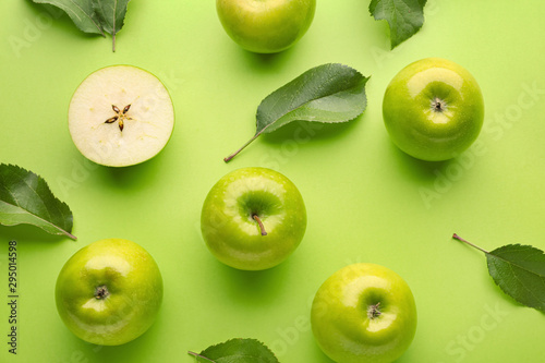 Fresh ripe apples on color background