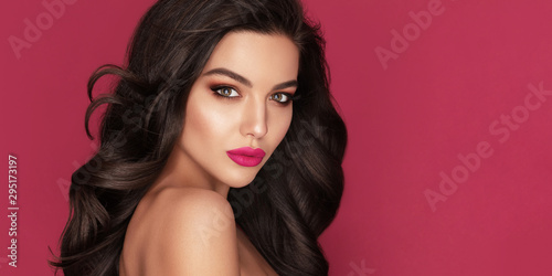 Valokuva Beauty Fashion Woman Brunette Portrait with brown eyes and Healthy Long Shiny Wavy black hair