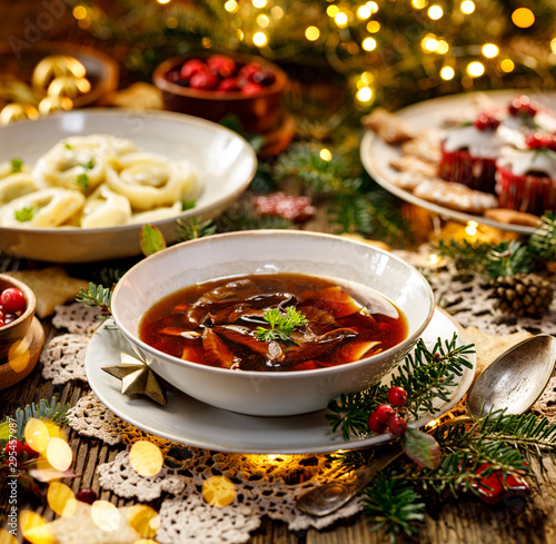 Canvas Print Christmas mushroom soup, a traditional vegetarian  mushroom soup made with dried forest mushrooms in a ceramik plate on a festive table