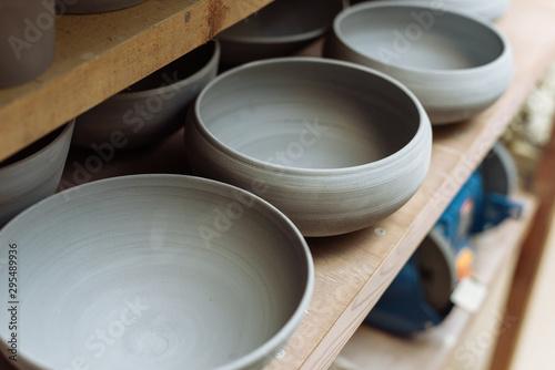 Gray handmade ceramic plates Fotobehang