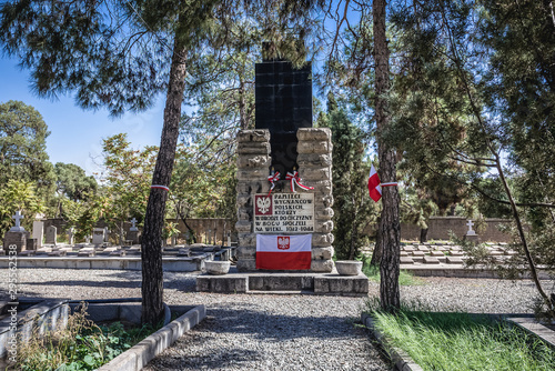 Memorial board and Polish flag on the Polish refugees section of Doulab Cemetery in Tehran, Iran