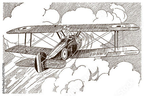 Canvas Print Antique british single-engine tractor one-seat biplane in back view, flying towa