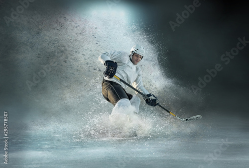 Photo Caucassian ice hockey Players in dynamic action in a professional sport game play in hockey under stadium lights