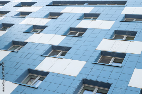 White and blue apartment building facade ground view. Poster Mural XXL
