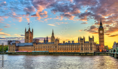 Fotografie, Obraz The Palace of Westminster in London at sunset, England