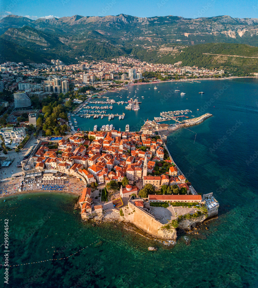 Aerial view of Budva, the old city (stari grad) of Budva, Montenegro. Jagged coast on the Adriatic Sea. Center of Montenegrin tourism, well-preserved medieval walled city, sandy beaches