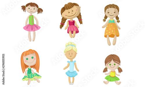 Canvastavla Set of fabric dolls in dresses. Vector illustration.