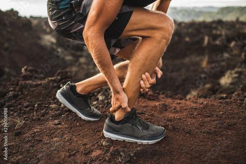 Photo Achilles injury on running outdoors