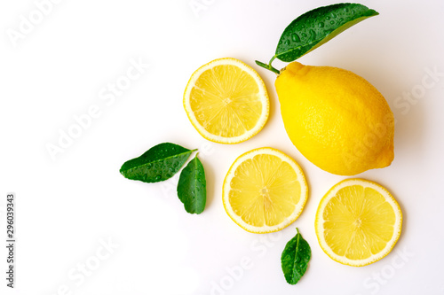 Slika na platnu Lemon lime fruit with green leaf and sliced isolated on white background
