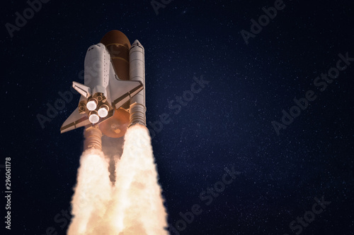 Fotografie, Obraz Space shuttle on dark starry background