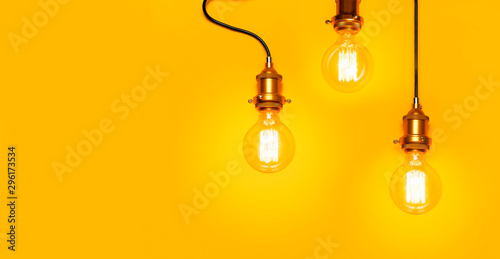 Vintage fashionable edison lamp on bright yellow background Fototapet