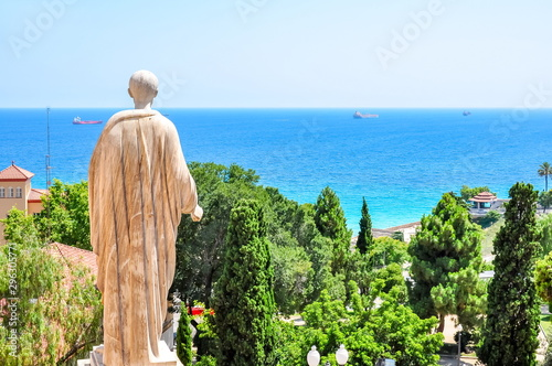 Ancient statue overlooking Tarragona seascape, Spain
