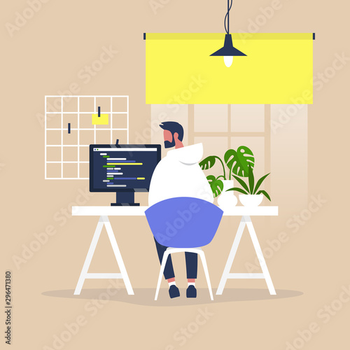 Fotografie, Obraz Tech industry, Young male web developer writing a code on a desktop computer in