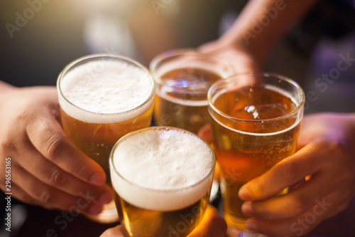 Fototapeta Cheers! Clink glasses