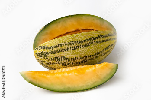 Stampa su Tela Striped yellow with green stripes an oblong melon with a carved slice on a white background